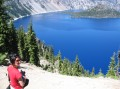 crater lake is a volcanic caldera formed by a volcano that blew a mile of its top off. it filled in slowly with rain water and melting show and therefore has no fish