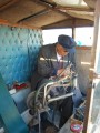 this man fixes shoes in a small, mobile box. he fixed my shoes too.